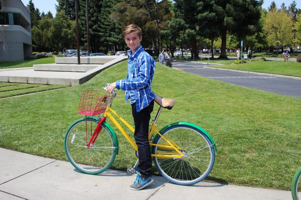 Alex on one of the colourful Google bikes